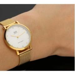 Relógio QeQ Feminino Dourado QA21J001Y